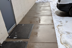 de-icing ice management as a post treatment on a sidewalk in Minneapolis